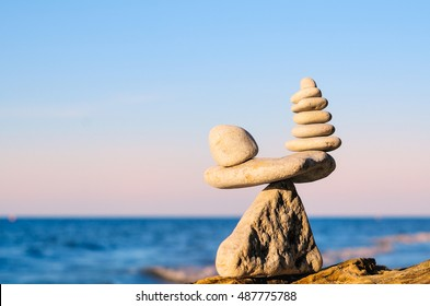 Balancing some of stones on the seashore