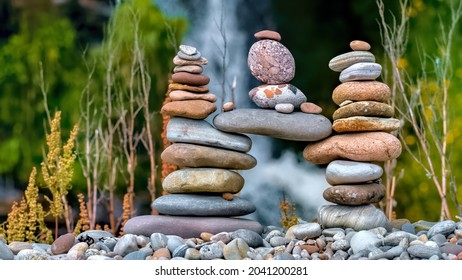 Balancing stone sculpture with Sputie waterfall in the Highlands of Scotland in the background wide depth of field