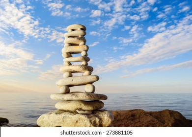 Balancing of stones each other on the seashore