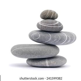 balancing stones isolated on white