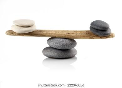 balancing stones on white background