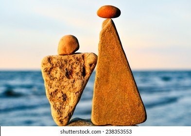 Balancing of two triangle stones on the seacoast