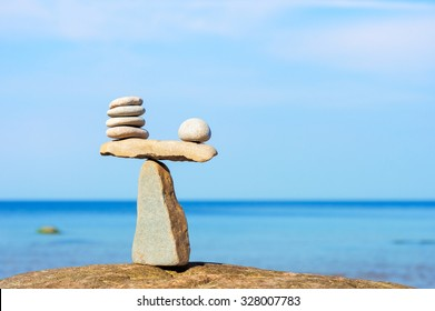 Balancing of white stones each other on the seashore