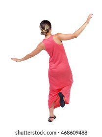 Balancing young woman.  or dodge falling woman. Rear view people collection.  backside view of person.  Isolated over white background. A slender woman in a long red dress balancing on his leg.