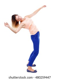 Balancing young woman. or dodge falling woman. Rear view people collection. blonde in a pink t-shirt falls on his back.