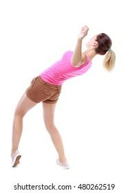 Balancing young woman. or dodge falling woman. Isolated over white background. Sport blond in brown shorts slipped and falls.