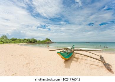 Balapitiya, Sri Lanka, Asia - A traditional, colorful canoe at the beach of Balapitiya