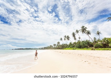 Balapitiya, Sri Lanka, Asia - A young woman enjoying nature at the beach of Balapitiya