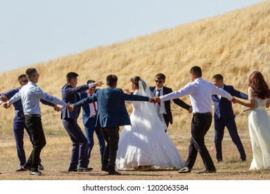 Balasagun, Kyrgyzstan - September 18, 2018 : Wedding party dancing at Burana Tower ruins in Balasagun, Kyrgyzstan.