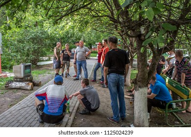 Balashikha, Moscow region, Russia - July 01, 2018: Russian fans watch the broadcast of the Russia-Spain match in the courtyard of the house