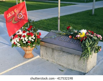 BALASHIKHA, RUSSIA - MAY, 9. Flowers at the memorial stone with the inscription Odessa on Victory Day on May 9, 2014 in city Balashikha, Moscow region, Russia.