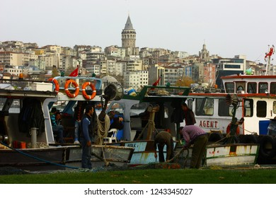 BALAT, ISTANBUL, TURKEY - 25 December 2012. A view from Balat coats with fishermen and boats. Galata Tower is at the other side of The Golden Horn.