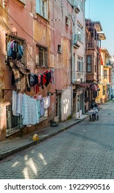 Balat, Istanbul, Turkey - February 23, 2021 - street photography of rundown houses with clothes hanging in Balat, Istanbul