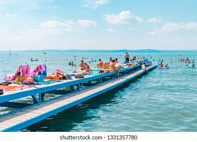 BALATON, HUNGARY - July 14, 2018: people swimming in blue azure lake. summer travel