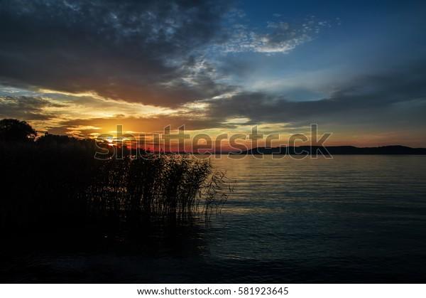 Balaton, sunset beginning in the clouds