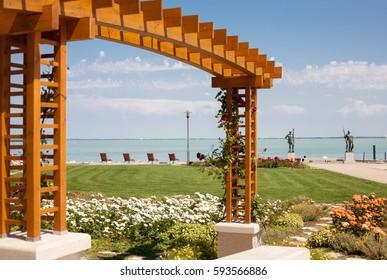 Balatonfured, Hungary - July 11, 2011: The beach of Lake Balaton with rose trellis and flower garden at Balatonfured, hungary