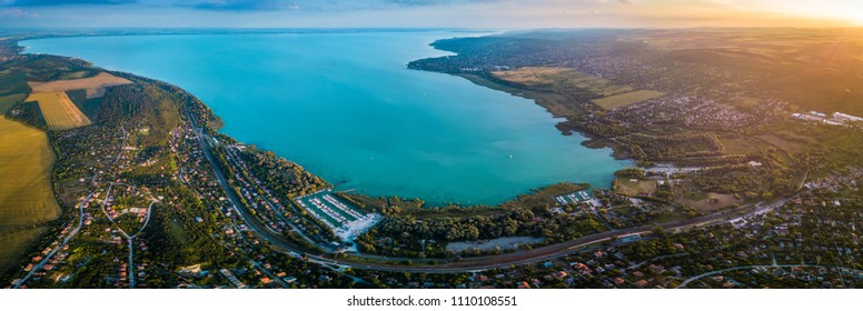Balatonfuzfo, Hungary - Panoramic aerial skyline view of the north-east corner of Lake Balaton at sunset. This view includes Balatonfuzfo, Balatonalmadi, Balatonkenese and several yacht marinas
