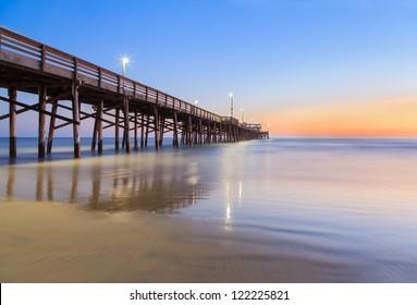 Balboa pier in Newport Beach, California after sunset, USA