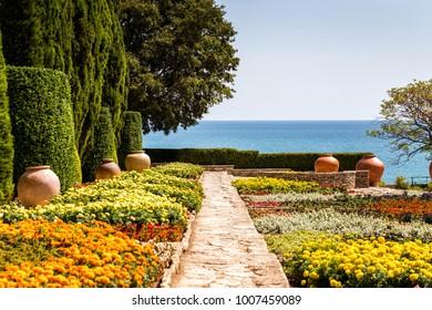 BALCHIK, BULGARIA - AUGUST 30, 2017: Botanical Garden, a part of the Balchik Palace of the Romanian Queen Maria. A famous tourist destination in the Bulgarian Black Sea town and resort of Balchik.