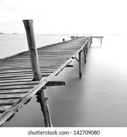balck and white picture of old bridge to the sea.