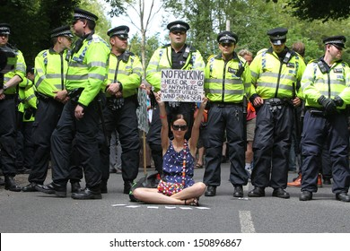 BALCOMBE, UNITED KINGDOM - AUGUST 18: A woman holds up a placard during an anti-fracking protest march against the energy company Cuadrilla on August 18, 2013 in Balcombe, UK.