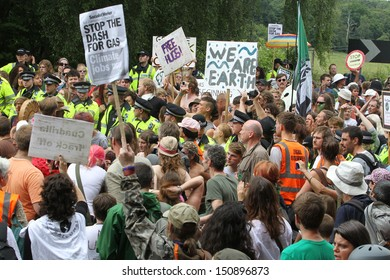BALCOMBE, UNITED KINGDOM - AUGUST 18: People gather together for an anti-fracking protest march against the energy company Cuadrilla on August 18, 2013 in Balcombe, UK.