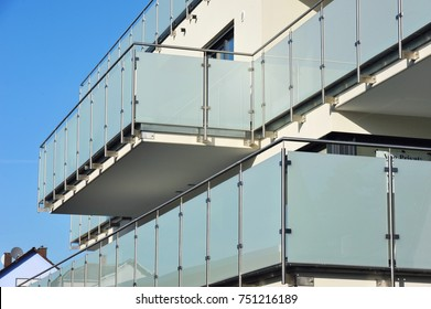 Balconies with Handrails of high-grade Steel and Glass in Front of a House