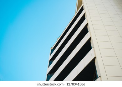 Balconies in modern office building. Aluminum composite panels. Azure sky copy space.