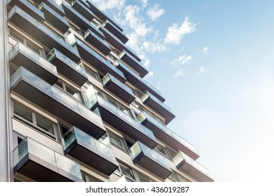 Balconies and windows of modern building with blue sky