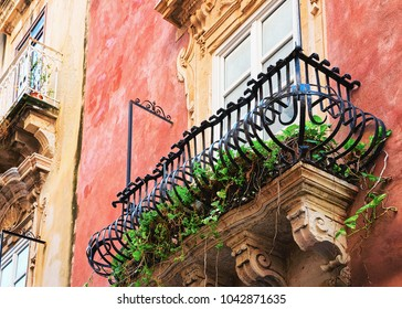 Balcony of an ancient building in Siracusa, Sicily, Italy