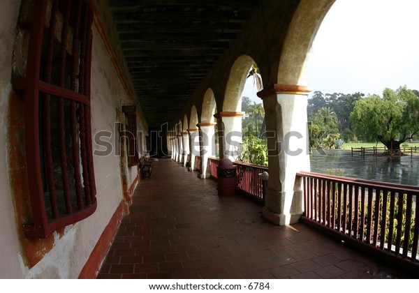 balcony archways overlook a courtyard