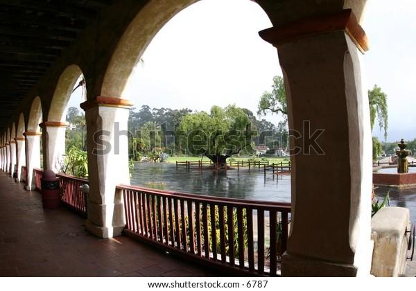 balcony archways overlook a courtyard