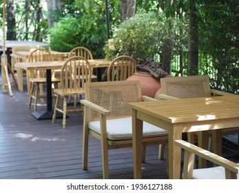 Balcony chairs in the back set with green plants
