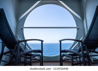 balcony with chairs on cruise ship with view on sea