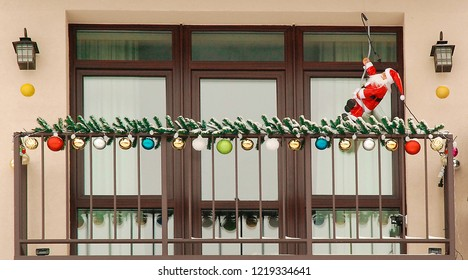 The balcony is decorated for Christmas with balls and garlands.