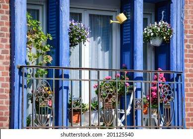 Balcony decorated with flowers in famous resort town Mers-les-Bains. (Picardy, France).