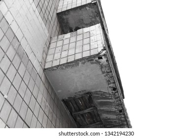 balcony in disrepair. old gray concrete balconiy with peeling paint and tiles, on the white background with copy space for text, bottom, low angle view