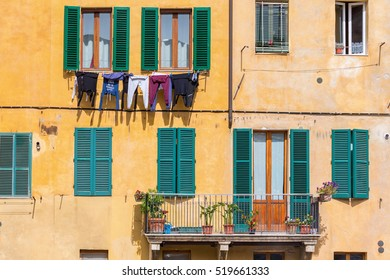 Balcony and drying clothes on the facade