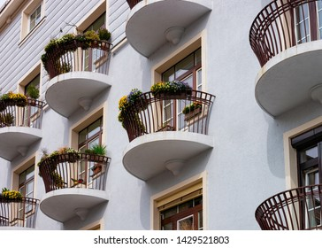 Balcony with flower pots in house building in the center of Celje old town in Slovenia. Flat architecture in Slovenija.