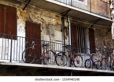 Balcony of french ancient architecture  building historical city center facade with family bicycle  tourism travel alp savoie france region chambery
