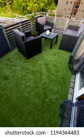 Balcony with furniture lighting and artificial grass