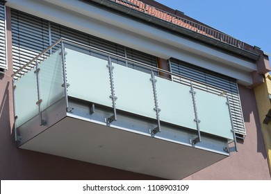 Balcony with Handrails of high-grade Steel in Front of a modern residential Building