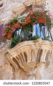 Balcony at a historic building in the old town of Pula in Istria in Croatia