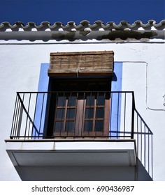 Balcony in Ibiza,House facade white an blue indigo colors in historic center of Ibiza, house of ibiza, Spain., , cobbled streets and steep,narrow streets