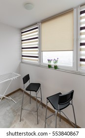 Balcony interior with windows and chairs in scandinavian style