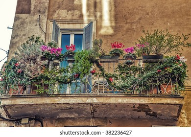 balcony of old Italian house with flowers and Christmas decorations