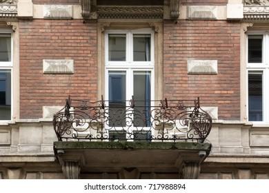 The balcony on the facade of a brick house