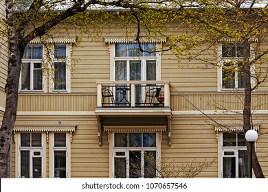 A balcony on wall of an old wooden house in Tallinn, Estonia. What a nice place for a couple of chairs and a table.