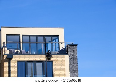 A balcony of a penthouse flat against a clear blue sky.  Taken in Cardiff Bay, Wales, UK