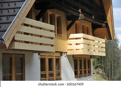 Balcony Rail of Wood in Front of a Black Forest Farm House